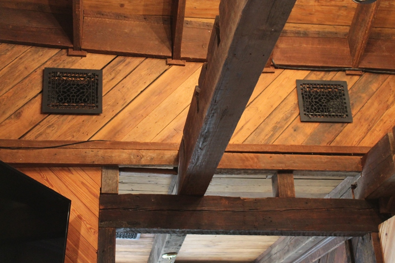 These are antique cast iron grates and exposed antique Heart Pine wooden beams.