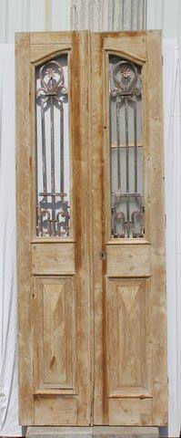 Check out this unique set of decorative doors from Egypt! One door has a smaller glass door on the back side. Dimensions: 36