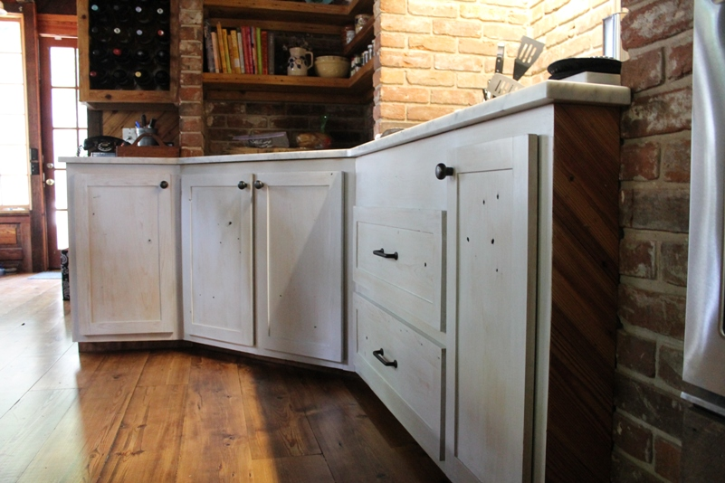 Our floors are antique wide plank Heart Pine flooring. The cabinets are custom made with ancient Cypress.