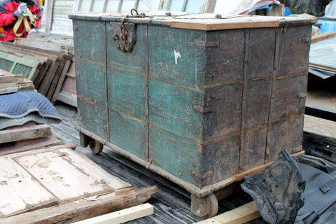 This solid teak storage trunk has hand forged metal hardware and charming wooden wheels. The price has not been determined.