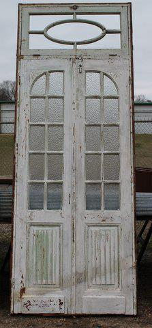 This set of doors with glass inlays are made from white pine. They are from North Africa. Dimensions: 41