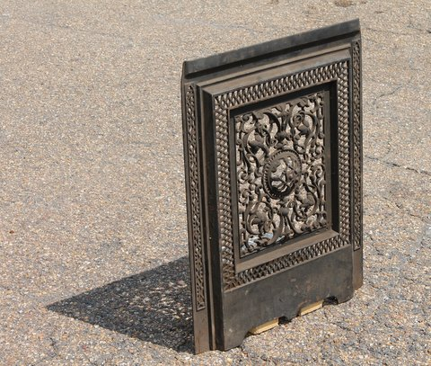 Here are some fancy fireplace covers from St. Louis. These cast iron pieces are selling at $100 each.