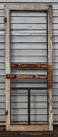 Check out this vintage Sunbeam Bread screen door, which was salvaged from an old general store. Dimensions: 30