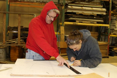 Molly and John make the pattern for the bulkhead.