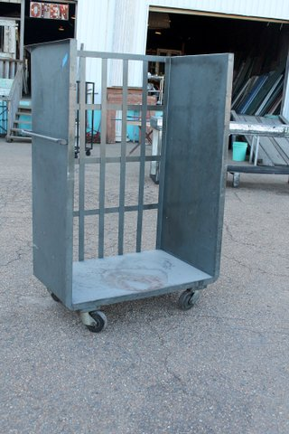 Industrial metal cart on casters, with push handles. Dimensions: 40