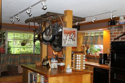 Here's another customer who's done something great with items he's gotten from us. Brian Mullins bought a harrow, and as you can see, he's using it as a pot rack. How creative!