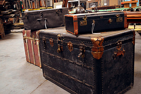 Vintage trunks and suitcases make for great storage and displays well within the shabby chic style.