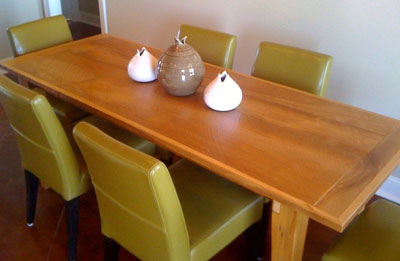Circular sawn Cypress table with tapered legs and bread board ends